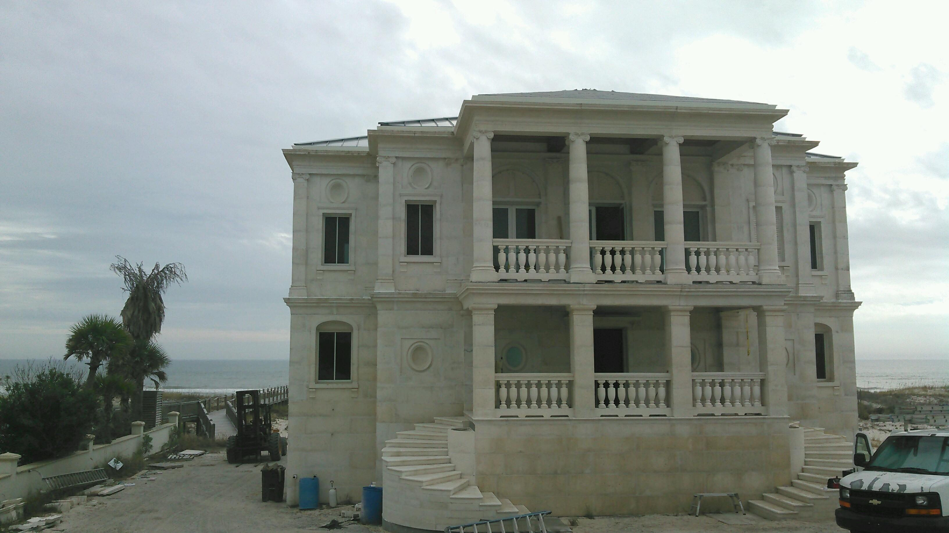 beautiful home being built by Dial Construction on the Gulf Shores AL coast in white DAC-ART stone